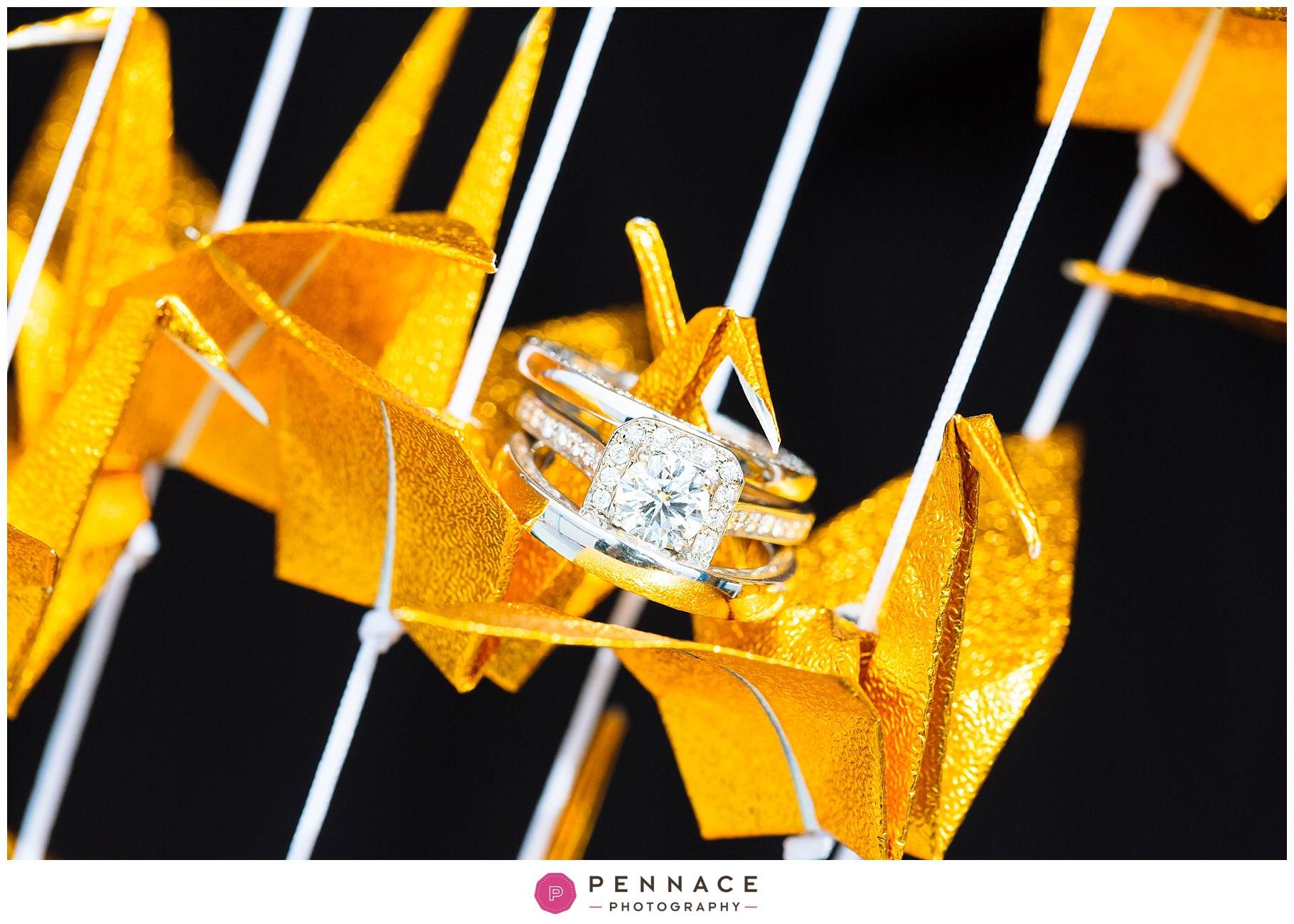 wedding rings on origami cranes